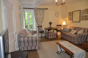 The first floor lounge with woodburner, threelarge settees and sky TV